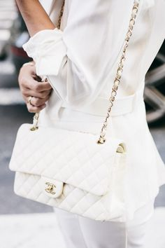 All white with a touch of Chanel.