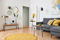 Mid-Century inspired living room with brass details and a grey couch. We love the yellow accents and the mix of modern and vintage pieces. Check out our website to find more inspiration! French Interior, Cafe Interior, Grey Couches, Modern, Contemporary, Yellow Accents, Living Room Grey, Small Apartments, Bunt