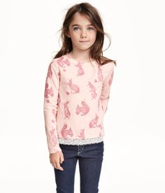 Long-sleeved top in cotton jersey with a printed design. Lace trim at hem.