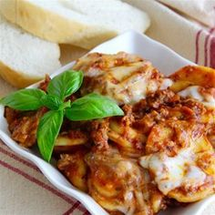 Randy's Slow Cooker Ravioli Lasagna - perfect for those summer time lasagna cravings when it's too hot to use the oven. Use spinach-cheese ravioli and sub out half the beef for Italian sausage.