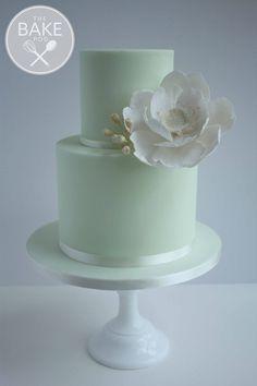 Mint green two tier wedding celebration cake with sparkly large fantasy flower. #weddingcake #mintgreen #sugarflower