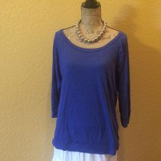 3/4 Sleeve, knit top ALL ITEMS ARE BOGO 50% OFF OF EQUAL OR LESSER VALUE ITEMRoyal blue, knit top with banded hem.  TRADES PAYPAL  HOLDSThanks for understanding! Old Navy Tops