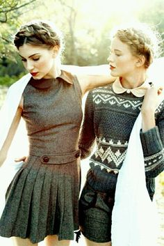 Tweed skater dress in grey, button belt in front, pleated skirt and boat neck, patterned sweater with shorts, both with collared shirts underneath and crown braids