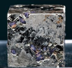 Pyrite cube with inclusions of purple Fluorite from Climax Mine, Colorado