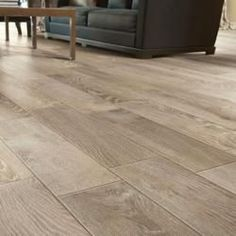 This living room floor is porcelain tile that looks like hardwood. The wood look tile is from the Rustic series and known as French Oak. Ceramic Tiles, Wood Look Tile, House Styles, Living Room Flooring, Flooring, Wood Grain Tile, Tile Floor, Porcelain Tile, Room Flooring