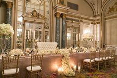 For ultimate elegance and sophistication, decorate your head table with gold candelabras, and let lush floral arrangements flow over into pillar candles.