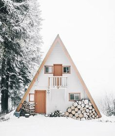 A FRAME CABIN IN THE SNOW