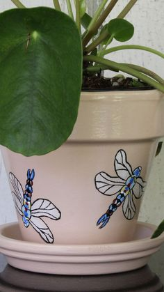 How many people think that dragonflies are cool? I do! They are wonderful insects that I just love watching so I just had to include them in my insect collection. Come check them out while they are still available. #potsetc #paintedplantpots #indoorplanters #paintedpots #dragonflies #beneficialbugs #entomology #natureindoors #terracottapots #paintedflowerpots #urbanjungle #houseplants #indoorjungle #homedecor #art #plantloversgift #giftforplantlovers #bestgiftforplantlovers #palepinkdecor Terracotta Flower Pots, Painted Flower Pots, Painted Pots, Q Tip Holder, Elegant Flowers, Indoor Planters, Salmon Color, Succulent Pots, Kids Decor
