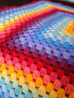 Ravelry: AmongGreenLeaves's Rainbow Sunburst Granny Square Blanket