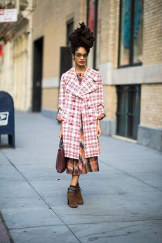Even with lines pointing in every direction, this multi-layered getup conquers winter with plaid-on-plaid perfection.