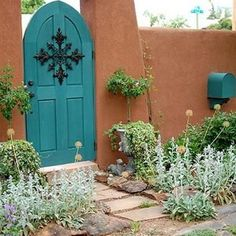 Wooden garden gates have to withstand a lot of variation in weather conditions, regardless of where you live. Southwest Style, Southwest Decor, Wooden Garden Gate, Garden Gates, Garden Entrance, Viva Color, Pintura Exterior, Santa Fe Style, Adobe House