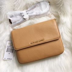 LOWEST✨ Michael Kors Bedford Double Gusset Crssbdy 8.5-in. W x 5.75-in. H x 1-in. D Foldover with magnetic snap closure Interior: 2 compartments, 3 slip pockets Adjustable crossbody strap Gold-tone hardware; self-color stitch trim Leather Imported MICHAEL Michael Kors Bags Crossbody Bags