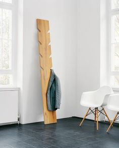 The coat rack CR01 MARTHA is made of a 30 mm (1 1/8 inch) solid wood leant against the wall. From 8 milled rounded cut-outs clothing can be hung... All materials used by e15 for its furniture are recyclable. Sustainability, human and environmental tolerance as well as degradability are all decisive factors for the choice of materials used for e15 furniture..