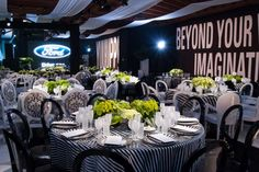 Striped tablecloths and mismatched seating offered a funky take on the theme at the 2011 event in Los Angeles. White messages decorated blac... Photo: Davide DePas Photography