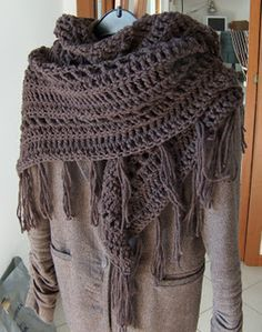 Love this. The pattern she links to is for a bigger shawl, but easy to make it shorter...