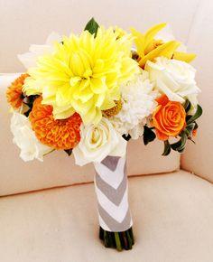 Yellow and orange dahlias, white roses and white mums.