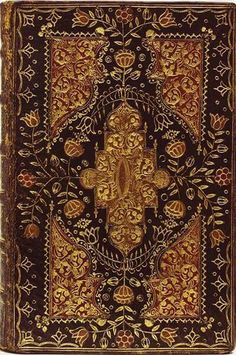 Holy Bible with Old and New Testaments, plus Psalms. 1700s.Black Moroccan binding, four cornered wit variety of florals.
