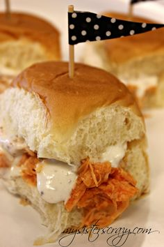 Crockpot Buffalo Chicken Sliders:  6-8 Chicken breasts, Frank's Red Hot/buffalo Sauce, Package Ranch Dressing,  Put in low crackpot for 5-6 hours.  Shred, remove extra juices and add additional Frank's sauce to taste.  Serve on King Hawaiian Rolls and ranch/bleu cheese dressing.