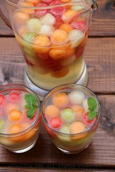 ~Melon White Sangria 3 cups of mixed melon balls (watermelon, cantaloupe, honeydew) 2-4 tablespoons of honey, adjust to taste 1 lime, juiced ¼ cup to ½ cup of grappa, adjust to taste – can also use pisco or a clear grape brandy 1 bottle of moscato wine, chilled ~ 1 ½ cups of sparkling water, chilled To serve and garnish: Mint leaves Lime slices Ice cubes or frozen melon ball ice cubes