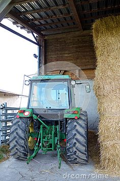 Photo about A Farm scene from Switzerland of a green tractor parked next to a stack of hay bails. Image of parked, rear, animal - 70998613 Permaculture, Switzerland, Tractors, Editorial, Scene, Stock Photos, Image, Stage