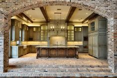 I am loving the use of exposed brick in this kitchen. My all-time favorite kitchen. Hands down.