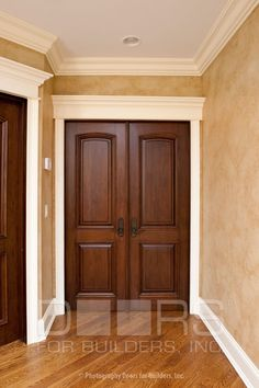 Dark wood Interior Door with white moulding I am going to go with