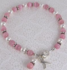 Breast Cancer Bracelet Pink Cat Eye White Pearl by JewelryByTali, $50.00