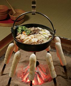 pamandjapan: きりたんぽ (Kiritanpo) Kiritanpo is a dish made of freshly cooked rice that was pounded until it was mashed, then formed into cylinders around skewers, and toasted over an open fire. It can be served with sweet miso or as dumplings in soups. Akita Prefecture, Japan, is well-known for its great kiritanpo.