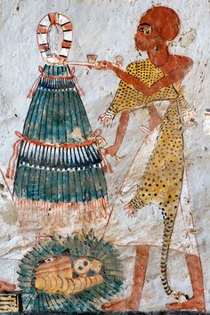 "[EGYPT 29369]<br /> 'Onions in Roy's tomb at Luxor.'<br /> <br /> A mural detail in the tomb of Roy shows a Sem priest in a leopard skin performing a fumigation with incense and a libation in front of a large bundle of onions, tied at the top by a red and white handle. This ""bouquet"" of onions was offered during the Feast of Onions and was meant to return the breath of life to the underworld god Sokar.<br /> Roy was an 18th dynasty royal scribe during the reign of Horemheb. His tomb (TT…"