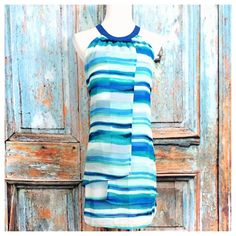 Blues/Navy/Aqua Striped Dress Sheer striped dress • white with shades of blue • back button closure with keyhole opening • polyester Dresses
