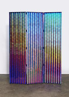 André Dubreuil; Blued Steel and Compact Disc Three-Panel Screen, c1990.
