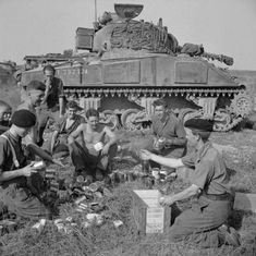 The crew of a Sherman tank of Northamptonshire Yeomanry receive rations before the start of Operation 'Totalise' August Ww2 Pictures, Sherman Tank, Battle Tank, Ww2 Tanks, American War, Armored Vehicles, World War Two, Military Vehicles, Wwii
