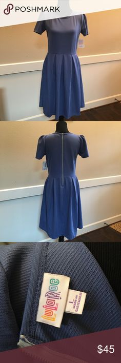 Lularoe Amelia Dress Blue Super soft Amelia dress in a beautiful shade of blue. Side pockets. Size Large. NWT. Top has 2 tiny pulls in the fabric that I tried to get in last photo. Priced accordingly. LuLaRoe Dresses