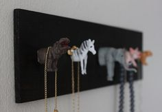 DIY Jewelry Holder | I would have spray-painted the animals gold, but it's cool that way also...