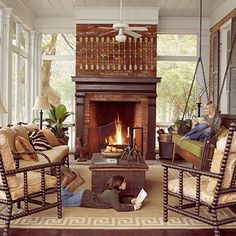 ADULT READING NOOKS   --   Space for Everyone, and a Fireplace!   What a great place for reading.  I dubbs the SWING...