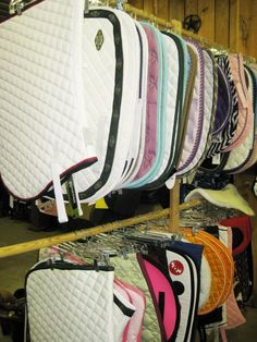 A clever idea for storing saddle pads in the tack room, adapted from this tack store's event booth. I like that you could give plenty of room to wet saddle pads, and when dry, store them closer.