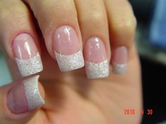 French manicure. Pinkish base coat. Glittery tips.