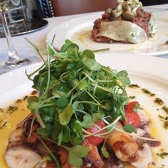 Slow braised octopus with limoncello & micro greens and steak tartare wrapped in trumpet mushroom