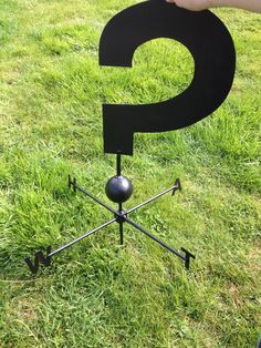 Hand made working question mark wind vane. Made from sheets of steal, forged together with W, H, A, T instead of N, S, E, W.