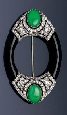 BOUCHERON - An Art Deco platinum, gold, onyx, jade and diamond brooch, Paris, circa 1925. Signed Boucheron Paris.