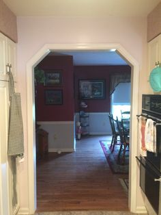 Before photo of kitchen area looking into dining room.