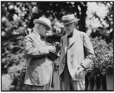 George Eastman, left, demonstrates his new Cine-Kodak camera and the Kodacolor three-color motion picture process for his guest, Thomas Edison, at the Kodacolor Party of June 30, 1928.