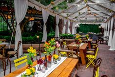 Farmtables, early sumemr flowers and mix n' match chairs for a casual, urban look