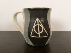 A personal favorite from my Etsy shop https://www.etsy.com/listing/253649819/harry-potter-dealthy-hallows-ceramic-mug