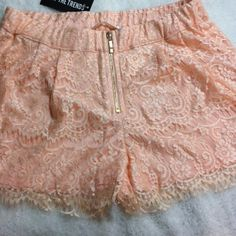 Must Have Lace Shorts Beautifully cute lace shorts in delicate peach pink color. Lace overlay with beautifully scalloped hem. Elastic waist and exposed front goldtone zipper. Pair with a solid top, high heels or flats, some jewelry and you'll be ready to go. Must Have Shorts