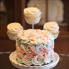 Simple and sweet tri color swirl rosette gender reveal mini cake - it's a .... GIRL!