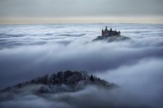 "German photographer Kilian Schönberger has captured the essence of the legendary Grimm Brothers' dark fairytales in a series of images called ""Brothers Grimm's Wanderings."" The photos capture entrancing landscapes and buildings throughout Central Europe that are at once mystical and foreboding."