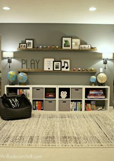 HUGE empty wall transformed into pretty game and toy storage! - Amy Perry - HUGE empty wall transformed into pretty game and toy storage! HUGE empty wall transformed into pretty game and toy storage! from Thrifty Decor Chick - Playroom Design, Design Room, Playroom Decor, Playroom Organization, Boys Playroom Ideas, Kids Playroom Storage, Kids Rooms, Organization Ideas, Storage Ideas