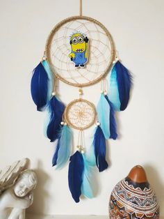 Made with attention and love this dream catcher brings its owners good dreams and positive energy. Materials: ~ two metal rings, natural jute cord ~ tan nylon string, wooden beads ~ navy blue and light blue feathers ~ embroidered minion Measurements: Dreamcatcher ring 6 inches across 17 inches length ( not cotton hanger) Authentic Dream Catchers, Dream Catcher For Kids, Big Dream Catchers, Blue Dream Catcher, Dream Catcher Decor, Feather Dream Catcher, Tribal Home Decor, Nautical Wall Decor, Nautical Nursery