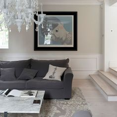 A contemporary living room is warm and welcoming with a soft warm grey on the walls, like CIL SE44 White Bucks / Chevreuil 10YY 72/021.